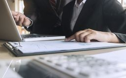 Business executives analysis data document with accountant at workplace.  stock photography