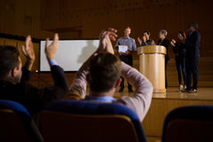 Business executives applauding. Business executives actively applauding in conference center Royalty Free Stock Photos