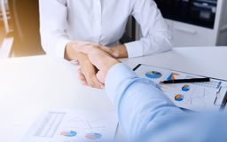 Business executives ceo handshake at meeting room.  stock photography