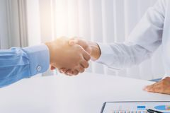 Business executives ceo handshake at meeting room royalty free stock photo