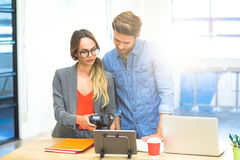 Business executives checking photos in camera Stock Image