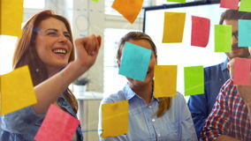 Business executives discussing over sticky notes