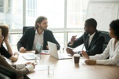 Business executives discussing project ideas at team meeting con stock photo
