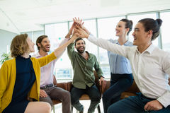 Business executives giving high five to each other Royalty Free Stock Photo
