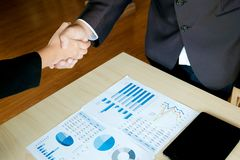 Business executives handshaking agreement project deal at a office.  stock photography