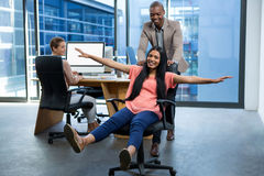 Business executives having fun in office. Cheerful business executives having fun in office Stock Photo