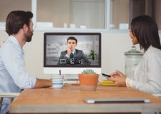 Business executives having video call with colleague on desktop computer Stock Photo