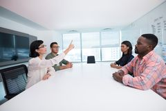 Business executives interacting in boardroom. At futuristic office Stock Photography
