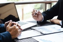 Business Executives meeting with data of sales performance at a modern outdoor workplace.  stock images