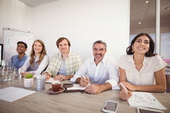 Business executives noting during presentation in office. Smiling business executives noting during presentation in office stock photography