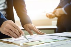 Business executives partner analysis data document with accountant at workplace.  stock photos