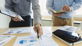 Business executives partner analysis data document with accountant at workplace.  stock photo