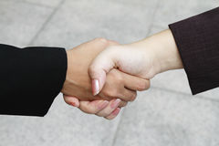Business executives power hand shake Stock Photos