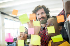 Business executives reading sticky notes royalty free stock image