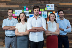 Business executives standing with arm crossed in office Stock Images