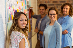 Business executives standing near whiteboard Stock Image