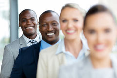 Business executives standing row. Group of happy business executives standing in a row stock images
