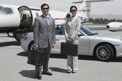 Business Executives Standing Together At Airfield Stock Photography