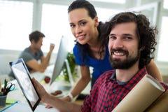 Business executives using digital tablet Stock Photos