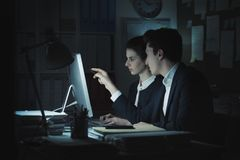 Business executives working in the office. Business executives working together in the office, they are discussing a project and connecting with a computer stock image