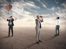 Business exploration for new opportunities. Business people looking for new job opportunities with binoculars Royalty Free Stock Photos