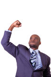 Business expressions. Young business man pumping his fist in the air Stock Photography