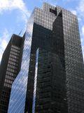 Business facade with lots of glass. Many reflections and blue sky (Manhattan stock photo