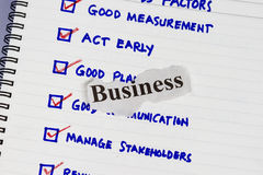 Business factors. Abstract with sketch and business cut out paper stock photo