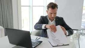 Business failing of young executive, stress of office boss on job, defeat in business deal,. Desperation businessman working on laptop in office space stock footage