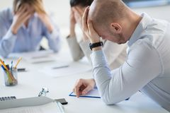 Stressed business team at office meeting stock photos