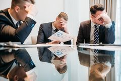 Business failure bankruptcy stressed defeated team. Business failure. prospective bankruptcy. stressed stunned crushed defeated team of company executives or Royalty Free Stock Photo