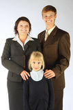 Business family. The business men, the business women and the little girl Stock Image