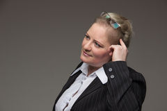 Business fat woman in a suit holding a glasses for vision Stock Photo