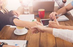 Business female handshake at office, contract conclusion and successful agreement. Business female handshake at office corporate meeting, contract conclusion and Stock Photo
