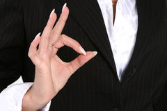 Business female showing an OK sign Stock Photography