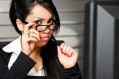 Business female teacher. Beautiful young female with glasses in the office Royalty Free Stock Images