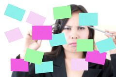 Business female thinking with sticky note. Royalty Free Stock Photos