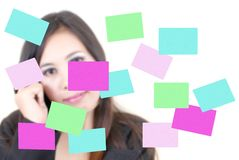 Business female thinking with sticky note. Royalty Free Stock Photography