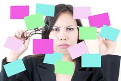 Business female thinking with sticky note. Stock Images