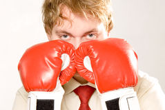 Business fight. Businessman with red boxer gloves Stock Images