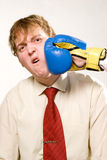 Business fight. Businessman receiving a boxing punch Royalty Free Stock Photo
