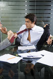 Business fight. Office life: business team having a fight Royalty Free Stock Photo