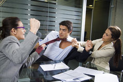 Business fight. Office life: business team having a fight Royalty Free Stock Photography
