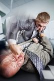 Business fight in the office. Two furious businessmen are fighting on the table Royalty Free Stock Photography