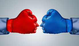 Business Fight Strategy. With two boxing gloves in the shape of human faces head to head and facing each other as competitive rivals and opponents in a Royalty Free Stock Image