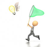 Business figure chasing a butterfly shaped light b Stock Photography