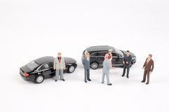 Business figure and toy car Stock Images