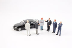 Business figure and toy car Stock Photo