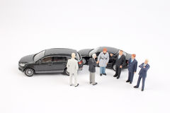 Business figure and toy car Stock Image