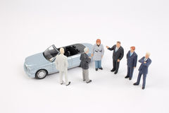 Business figure and toy car Royalty Free Stock Image